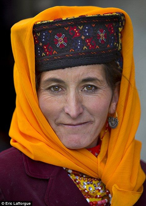 Uighur woman in a colourful traditional hat | photographer Eric Lafforgue