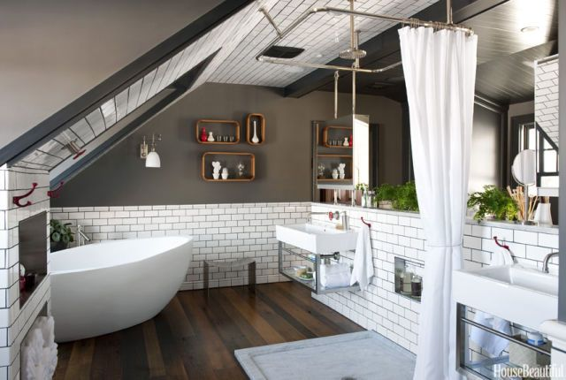 To divide his master bathroom into bath and dressing areas, designer Dan Ruhland built a half-wall tiled in Cotto subway tile. Medicine cabinets are hung over Lacava Aquagrande wall-mounted porcelain and stainless-steel sinks. The shower curtain is suspended on Strom's shower pan enclosure; it can be pulled around the Carrara basin or pushed aside with tiebacks.