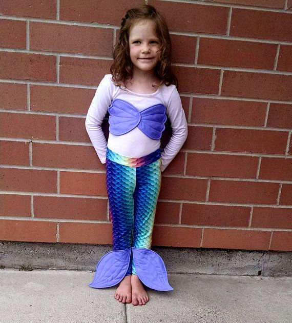 You just cant get better than a RAINBOW mermaid! Choose any color of tail fins and sea shell top that youd like! Just leave me a note when you order! This Mermaid costume is perfect for your Princess to be able to WALK around in easily but still have the look of a real Mermaid tail! This material is a high quality, poly spandex with the scales printed on making this tail look like a real fishy wonder! Sea shell bra is made from satin and has a color coordinating ribbon to tie on around the…