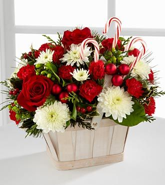 Flowers, balls and candy in a basket.
