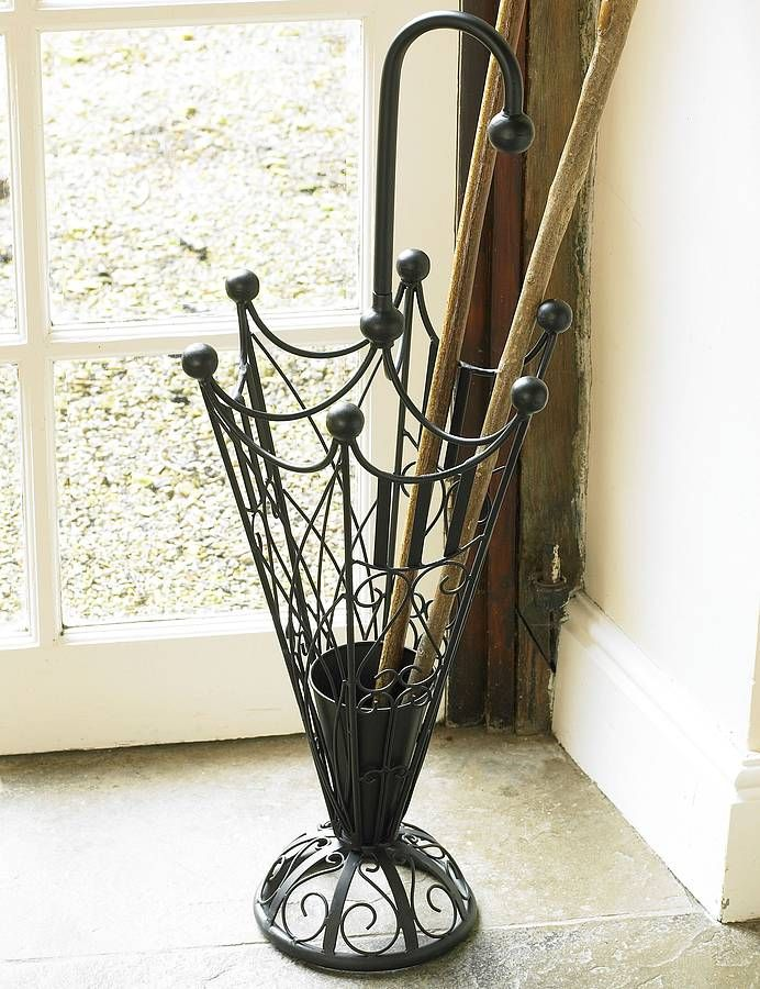 Umbrella stand add hooks for hanging from draw string - Percheros paragueros antiguos ...