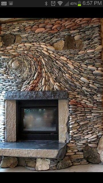 This rock mosaic above the fireplace is amazing! Such talent, such time <3