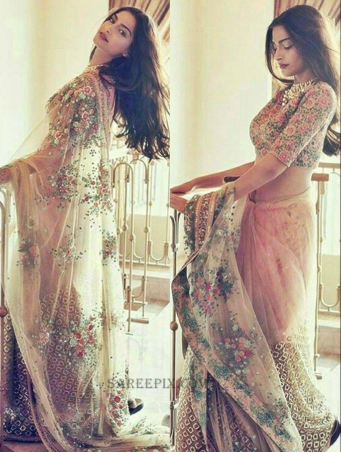 Fashion diva Sonam Kapoor saree at Bazaar Bride India photoshoot. She looks eye catchy in bridal saree with high neck blouse.