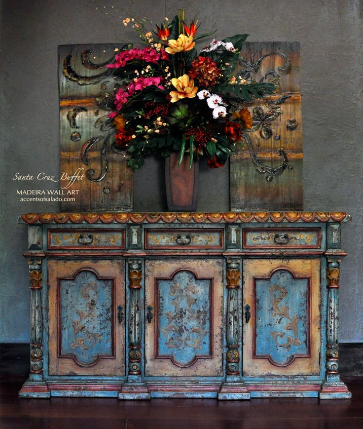 Add a punch of Turquoise and Orange to the Tuscan dining room with the Santa Cruz buffet and Madeira Wall Art. Find the colors you love to love at Accents of Salado. We ship nationwide.