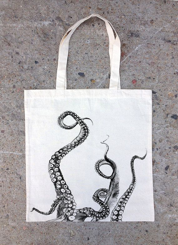 This hand printed cotton canvas bag features a detailed screen print of octopus tentacles climbing up the front side of the bag. Hand drawn