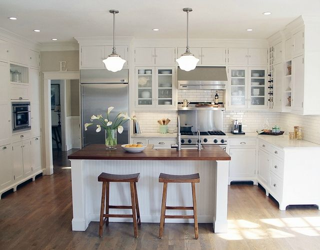 White kitchen with bead board, subway tile, butcher block island... LIke the counter top combo