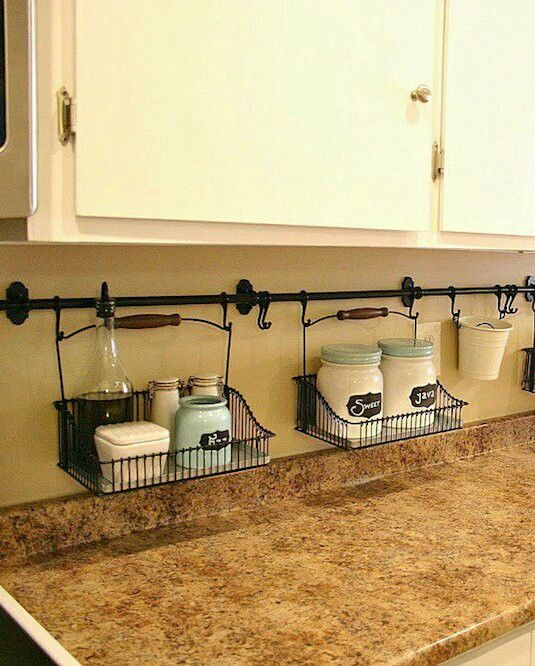 Under cabinet, off the counter storage idea: Towel rod(s) w/o hooks to hang wire baskets.