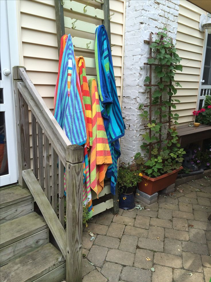 Outdoor towel drying rack! ! My stepmom refashioned this old porch railing into a drying rack for beach/pool towels. Bought at a local knick knack shop, she repainted it, added hooks and turned it on end. GENIUS. She births pinterest-worthy ideas on a daily basis!