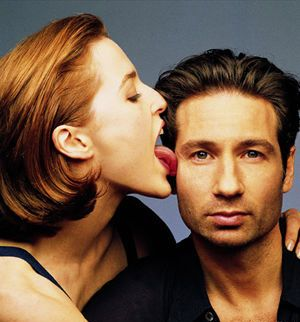 Love how David Duchovny looks like he's trying to pretend his co-star is not licking him on the face. #xfiles