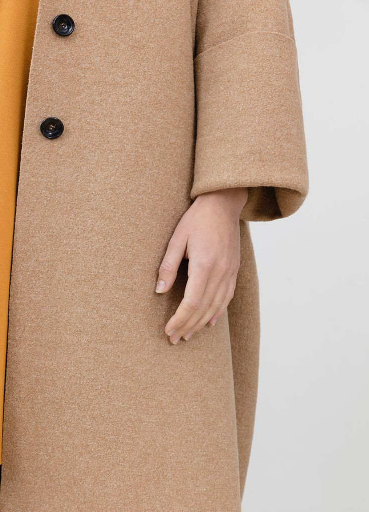 Oversize coat out of wool in camel, but available also in other colors, and 3 / 4 sleeves dress in mustard out of high quality viscose, pa and jersey #simpelthen #purity & #style #handmade in #switzerland