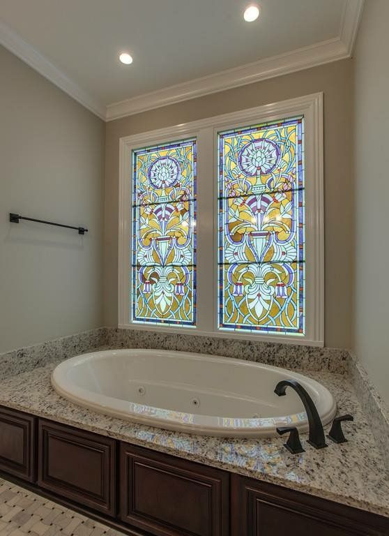 Stained glass windows above master bath tub Dream Home Bathrooms