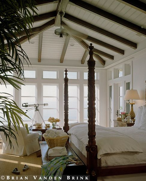 light, bright and serene ocean front british colonial style bedroom features tongue in groove ceiling & carved mahogany 4 poster bed with crisp white linens <3