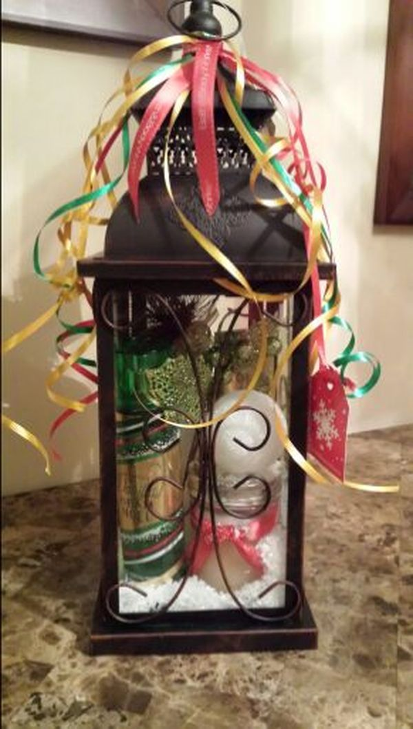 New (never used) - Basket includes candle lighthouse, Victoria Secret Vanilla Bean body mist & Body cream, body scrum, and Christmas tree ornament