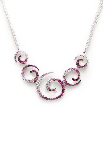 "This beautiful necklace from the ""Zingara"" collection by Stefan Hafner features wonderful variagated color in an elegant scroll design. Set with 2.02ctw pink sapphires and .59ctw white diamonds, the n"