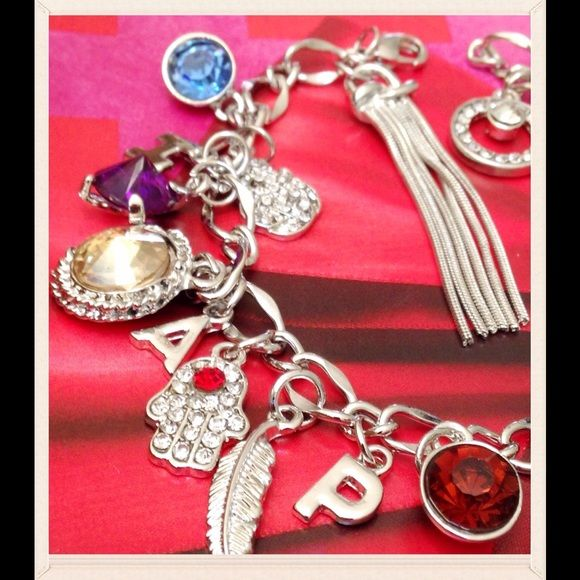 """CHARM SET-3 Ways To Wear This is such a beautiful and versatile set. There is a 9"""" bracelet filled with charms. In addition there is an additional 11"""" link bracelet which can be worn alone or as an anklet. It can also be added as an enhancer to the charm bracelet to make a 20"""" charm necklace! The charms are beautiful and plentiful with charms interspersed that spell """"HAPPY"""". Great piece for anyone's jewelry wardrobe. FINAL Price Jewelry"""
