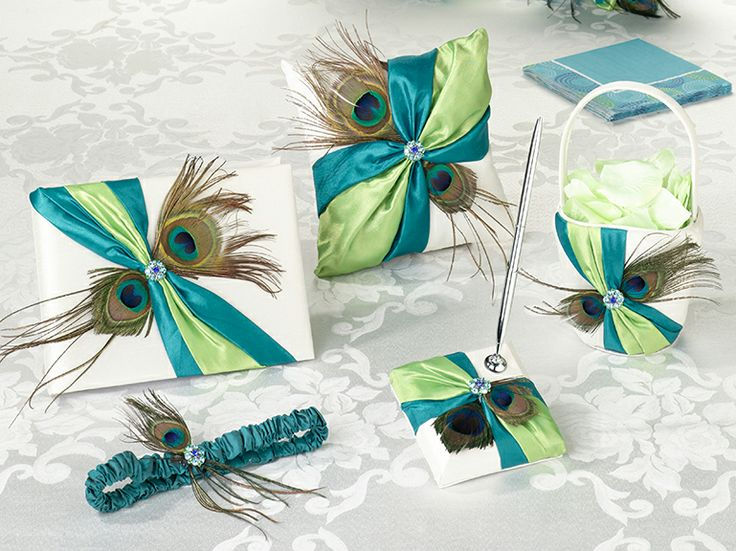 Unique peacock wedding set will set you apart from all the rest with vibrant colors and wispy feathers; bold but romantic, original yet vintage.  This set is sure to have your guest know your wedding is making a statement.  This pecock wedding set includes six wedding accessories essential  to completing your perfect day.  Included are the following items:  one  10 x 6.5 guest book, one 3.25 x 5.25 pen set, one 7.5 ring pillow,  one 7.5 flower basket and one garter.