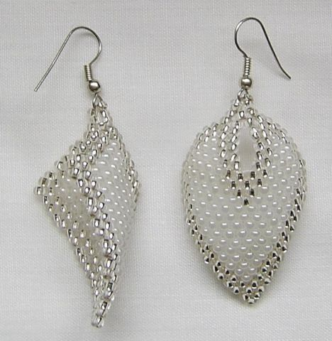 Beautiful beaded earrings, wintery elegant color scheme, follow the link for peyote stitch diagram.