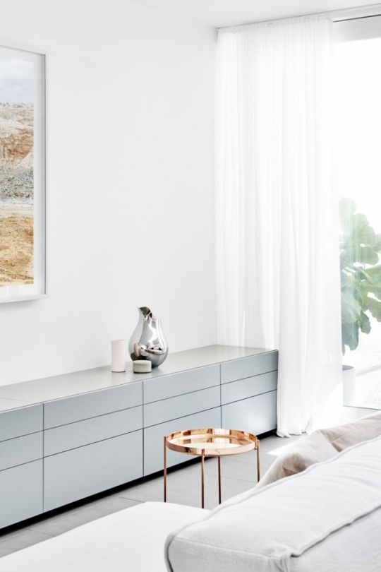 Renovation: a tranquil Melbourne living room: Metallic pieces, such the polished copper E15 'Habibi' tray side table fromLiving Edge, beautifully complement the pastel palette.The artwork is by Dan Hocking 'Sans' series.