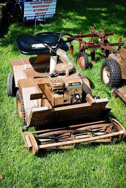 Old Riding Lawn Mower by DaKohlmeyer, via Flickr