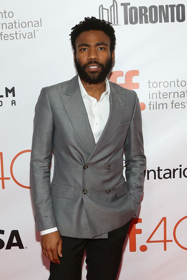 Donald Glover in a double breasted gray suit at 'The Martian' premiere during the 2015 Toronto International Film Festival at Roy Thomson Hall.