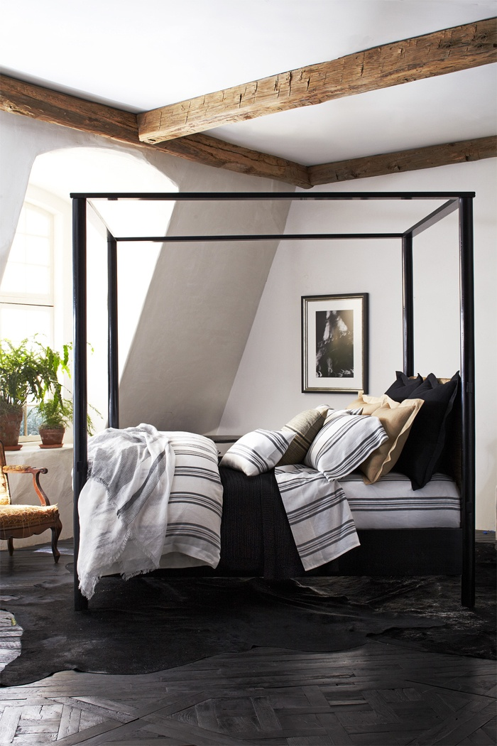 The Camargue Bed: With a four post canopy frame, this bed boasts head and footboards made of woven seagrass