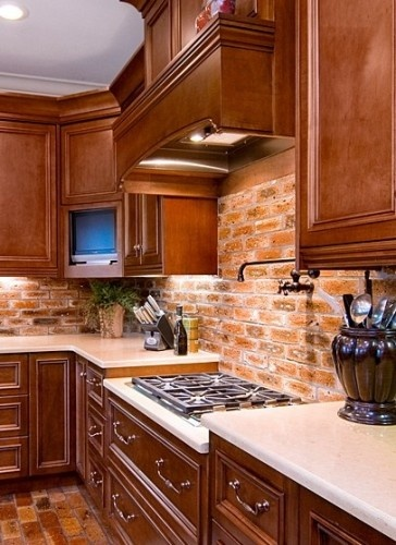 Sort Of Red Cabinets With Brick Backsplash. Not Sure About The White  Countertops