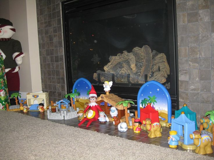December 18, 2014 ~ Sparky with our little people nativity set, holding baby Jesus. The main reason we celebrate Christmas!