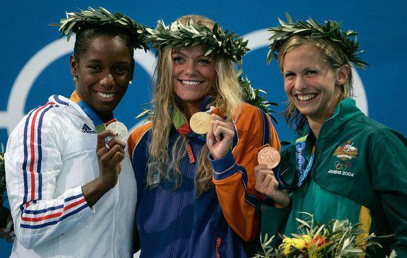 Malia Metella of France wins the silver medal, Inge de Bruijn of the Netherlands wins the gold medal and Lisbeth Lenton of Australia wins the bronze medal