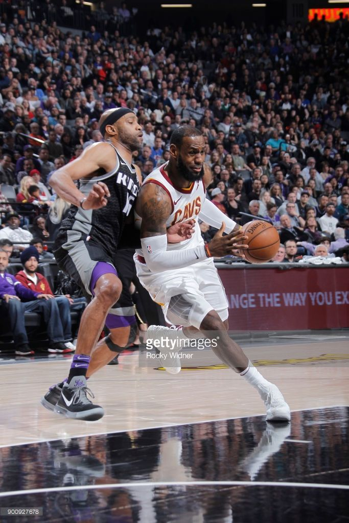 3a71f49b5d0ad9 LeBron James  23 of the Cleveland Cavaliers drives against Vince Carter  15  of the Sacramento Kings on December 27