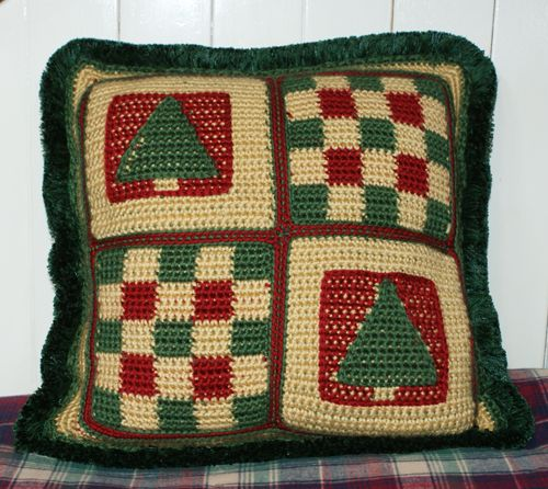 This Christmas-friendly pillow could be used all winter long. The pine tree motifs are suggestive of winter, and would be perfect for decorating a home, mountain cabin or ski lodge.