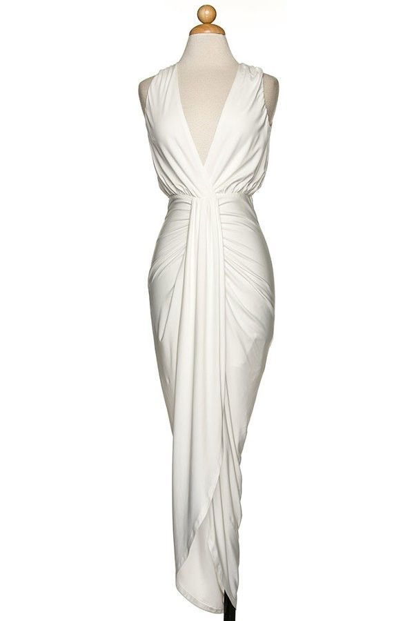 Elegant sleeveless dress with v-neck bust and ruched and draped in front.