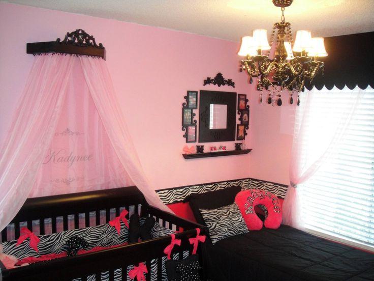 pink zebra nursery. i love the drape over the crib for a girl