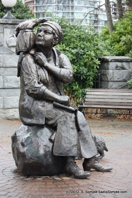 Emily Carr (1871 - 1945) with monkey Woo and dog Billie