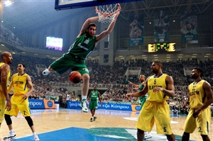 Panathinaikos' Kostas Kaimakoglou dunks against Maccabi during their Euroleague basketball game in Athens on March 22, 2012.