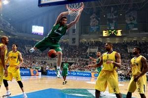 Panathinaikos' Kostas Kaimakoglou dunks against Maccabi during their Euroleague basketball game in Athens on March 22, 2012.