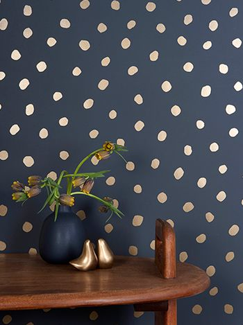 Navy wallpaper with gold dots. Juju Papers:Sisters of the Sun