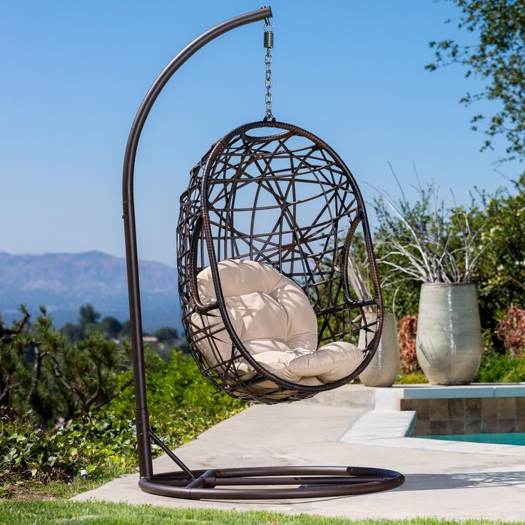 Swing Through Sunny Days In This Sturdy Outdoor Wicker Chair. The  Weather Resistant Metal Frame Ensures Stability, While The Plush Cushion  Provides ...