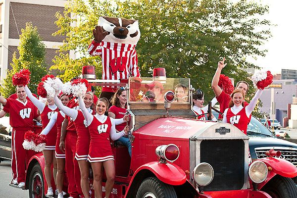 I remember sophomore year, when this truck came down the street and distracted me-I stepped into the bike lane and got nailed! Concussion for me! Still makes me smile! Bucky and the Spirit Squad hitch a ride on the Bucky Wagon.