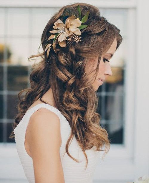 The elegant half up half down hairdo always plays an important part for wedding hairstyles.