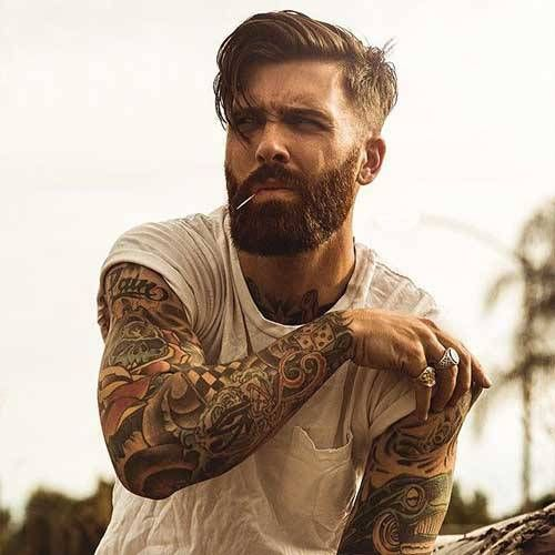 medium hair undercut hairstyle with beard
