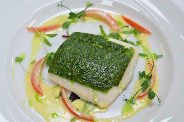 Market white fish with a soft herb crust and herb butter sauce