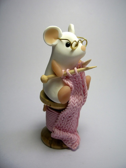 looks like mommy.. just trade the knitting for cross stitch :p