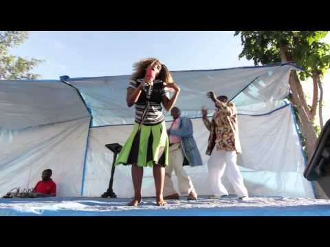 African music, singing and dancing during Christmas meeting in a church. Tanzania, Africa.