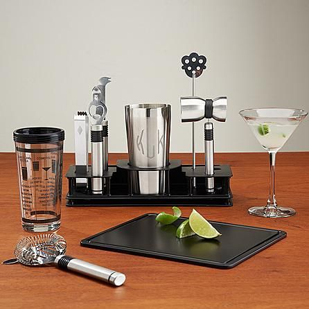 Here's everything he needs to get the party started! Contemporary bar tool set includes a 2-piece glass and stainless steel cocktail shaker set, double jigger, cocktail strainer, chopping board and more—all housed in a sleek rectangular stand to keep them within easy reach.