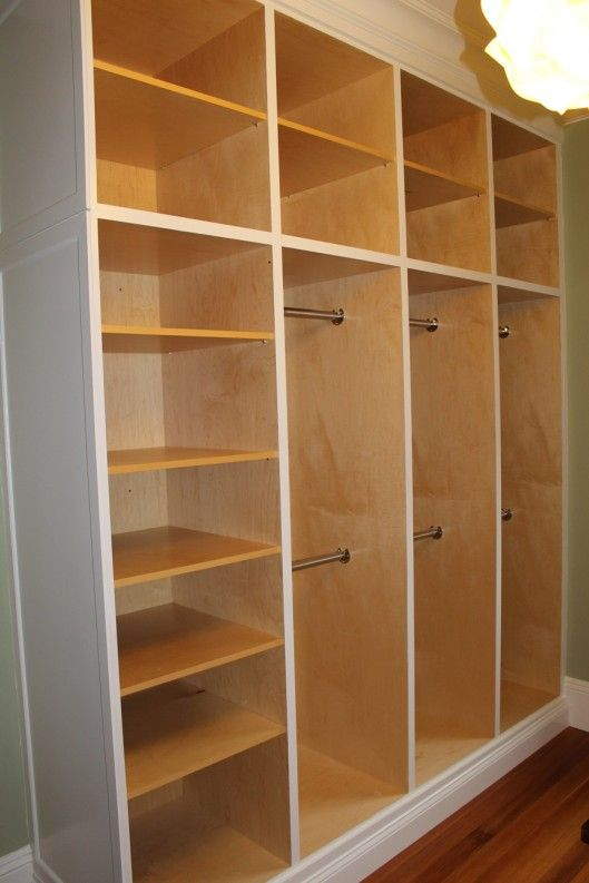 Custom Closet Organizer  separate sections could have different level rods for different types of clothes and accessories.  Lots of shelves :-)