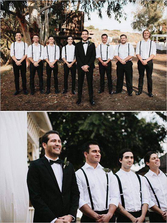 black and white groomsmen in suspenders