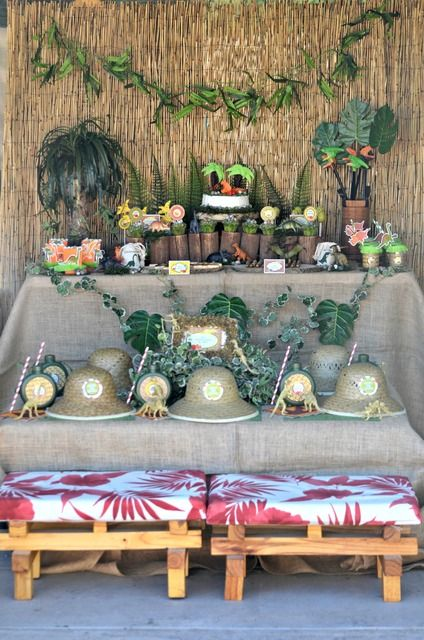 Love the burlap on tables, the bamboo backdrop, and the big leaves. Can totally add hibiscus flowers to make a luau theme for a boy!