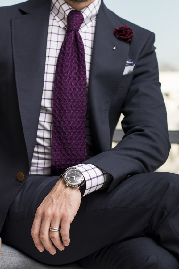 Navy suit, white shirt with with purple windowpane check, purple knit tie