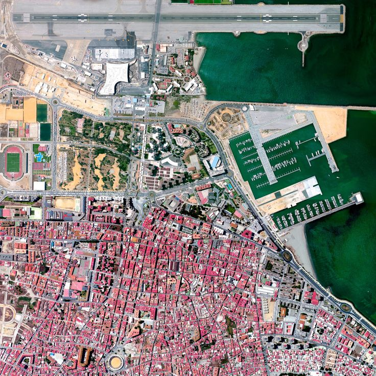 7/27/2015 Gibraltar International Airport Gibraltar 36°09′04″N 005°20′59″W   Check out this zoomed-in look at one of the prints that was added to our store yesterday. The Overview captures the Gibraltar International Airport, serving the British overseas territory and neighboring areas of southern Spain. Winston Churchill Avenue - the road to the border with Spain - intersects the airport runway and has to be closed every time a plane lands or departs.
