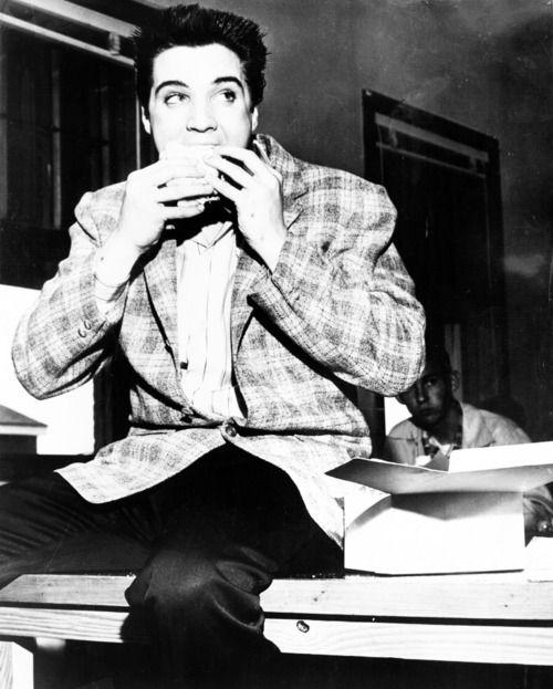 Elvis eating a sandwich